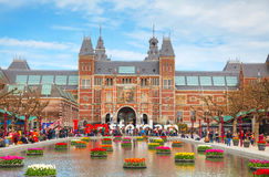 I Amsterdam slogan with crowd of tourists. AMSTERDAM - APRIL 16: I Amsterdam slogan with crowd of tourists on April 16, 2015 in Amsterdam. Located at the back of stock image