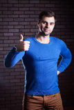I approve. Cute young guy showing thumbs up Royalty Free Stock Images