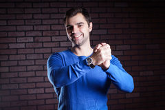 I approve. A young man shows gesture of support and encouragement Royalty Free Stock Photo