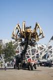 I Asien parkerar Kina, Peking som är olympisk, spindeln, det franska mekaniskt ståtar Arkivfoton