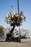I Asien parkerar Kina, Peking som är olympisk, spindeln, det franska mekaniskt ståtar Arkivbilder