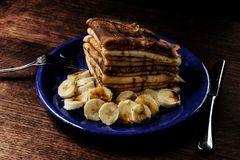 Pancakes with banana royalty free stock photos