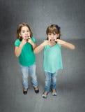 I bambini hanno fatto la lingua con il dito Fotografia Stock Libera da Diritti