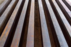 Rusty I-beams arranged in rows. I beams manufactured and arranged in rows waiting to be transported Royalty Free Stock Photos