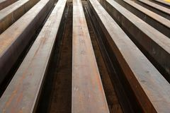 Rusty I-beams arranged in rows. I beams manufactured and arranged in rows waiting to be transported Stock Images