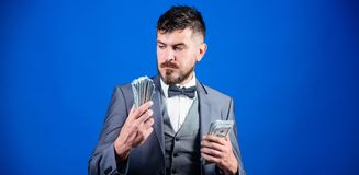 I believe in banknotes. Bearded man holding cash money. Rich businessman with us dollars banknotes. Currency broker with. Bundle of money. Making money with his royalty free stock photo