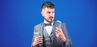 I believe in banknotes. Bearded man holding cash money. Rich businessman with us dollars banknotes. Currency broker with royalty free stock photo