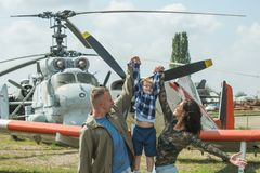 I believe I can fly. Family couple with son on vacation travel. Woman and man with boy child at helicopter. Air tour and. I believe I can fly. Family couple with stock photography