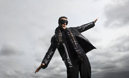 I believe I can fly. Male model poses as a pilot royalty free stock images