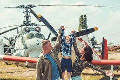 I believe I can fly. Family couple with son on vacation travel. Woman and man with boy child at helicopter. Air tour and. I believe I can fly. Family couple with stock photos