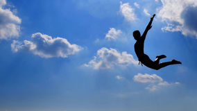I Believe I Can Fly. Flexible boy jumping to sky royalty free stock photos