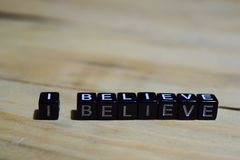 I believe message written on wooden blocks stock images