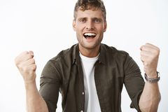 I believe in you. Portrait of supportive cheering handsome man with blue eyes and white broad smile trying encourage. Friend clench fists in victory and triumph stock image