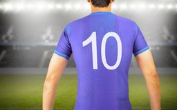 I am the best number ten. Back of a football player with the number ten wearing a blue t-shirt at football stadium in background stock images