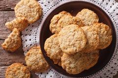 I biscotti al forno dell'australiano ANZAC si chiudono di recente su cima orizzontale Fotografie Stock