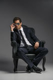 I am a boss. Confident young businessmen in sunglasses sitting o Royalty Free Stock Image