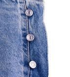 I bottoni del diesel sui jeans Fotografia Stock
