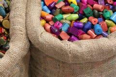 I bottoni fatti con avorio vegetale hanno scolpito dal dado di un tropi Fotografia Stock