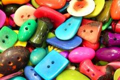 I bottoni fatti con un materiale hanno chiamato l'avorio vegetale che è obta Fotografie Stock