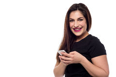 I bought a new smart phone. Smiling woman posing with new mobile phone Royalty Free Stock Photos