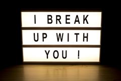 I break up with you light box sign board. On wooden table royalty free stock photos