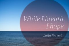 Breath, hope proverb. While I breath, I hope - ancient Latin Proverb printed over photo with calm sea landscape Royalty Free Stock Photos