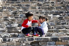 Children playing on the Great Wall,Beijing,China stock images