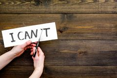 I can concept. Motivate youself, believe in yourself. Hand cut off the letter t of written word I can`t by sciccors stock photos
