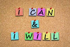 I can and I will motivation words with adhesive notes and pins on cork billboard. I can and I will motivation words with adhesive notes and pins on cork board stock photography