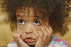 I Can Make This Face... A beautiful mixed race little girl pulling a face Stock Photos