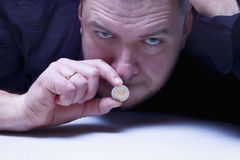 I can not say anything. The mouth of a man closes with coins mon Stock Photos
