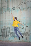 I can reach even the sky. Jumping man in the background with and illustrated city Royalty Free Stock Image