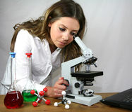 I can see clearly now... A biology student uses her microscope and laptop computer stock photo