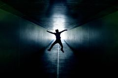 I can see the light. Teenager jumping inside a tunnel Stock Photography