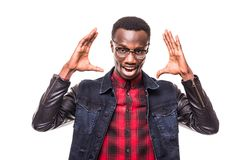 I can`t believe this. Amazed young African American hipster wearing trendy glasses and checkered shirt over white t-shirt holding. Amazed young African American Royalty Free Stock Image