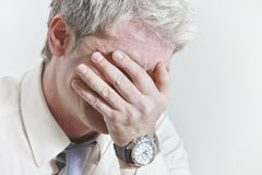 I can´t endure it anymore. Businessman having head ache as a result of being under pressure Royalty Free Stock Photo