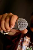 I can't hear you?!. Male rap singer holding the mic to the audience Royalty Free Stock Photo