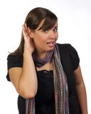 I can't hear you. Young woman making an I can't hear you expression Stock Photography