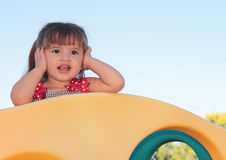 I Can't Hear You. Image of young toddler girl covering her ears so she can't hear Stock Images