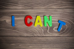 I can't and i can motivation lettering on wood background Royalty Free Stock Photography