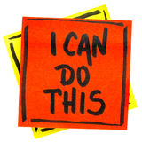 I can to this positive affirmation. Handwriting in black ink on an isolated sticky note royalty free stock photos