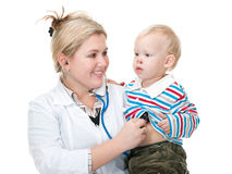 I can treat you, baby!. A doctor is holding a toddler and examining him; isolated on the white background Stock Photo