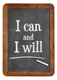 I can and will motivation text on balckboard Stock Photo