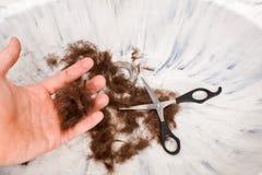 I capelli Scissors la mano Immagine Stock
