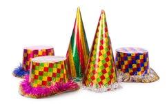 I cappelli del partito isolati sui precedenti bianchi Fotografia Stock