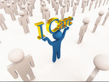 I care. Caring customer service concet, man holding the words i care lined with gold, with others just standing by, showing unique company or person who cares Royalty Free Stock Photo