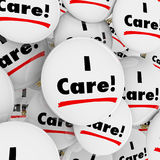 I Care Words Button Caring Compassionate Helpful People Workers. I Care words on buttons for caring, compassionate or helpful people, customer support or service Stock Photography