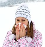 I Caught A Cold. Unhealthy woman blowing her nose in the cold winter Royalty Free Stock Images