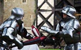 I cavalieri combattono fotografia stock