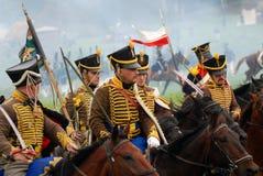 I cavalieri del cavallo a Borodino combattono la rievocazione storica in Russia Fotografia Stock Libera da Diritti
